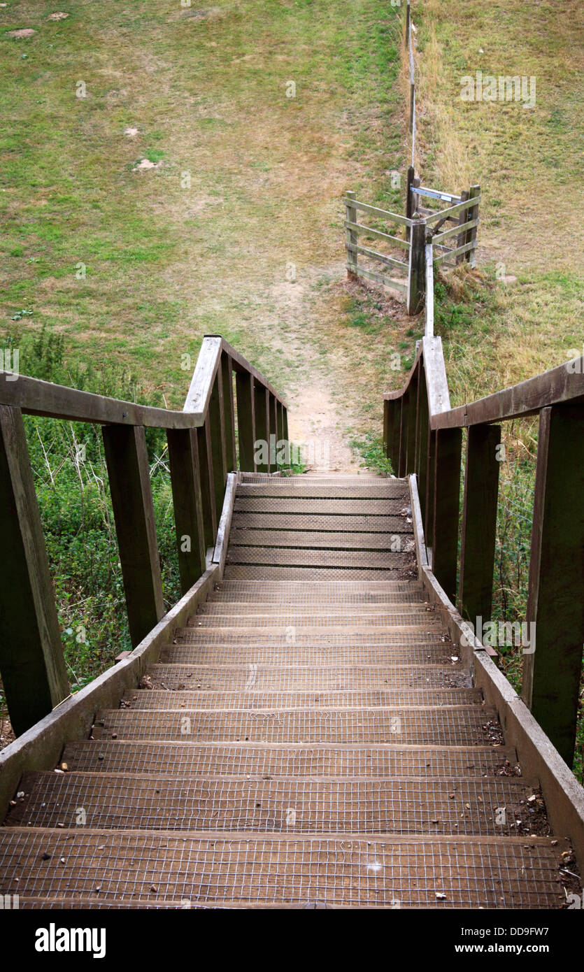 A view of a steep flight of wooden steps looking downwards from the top. - Stock Image