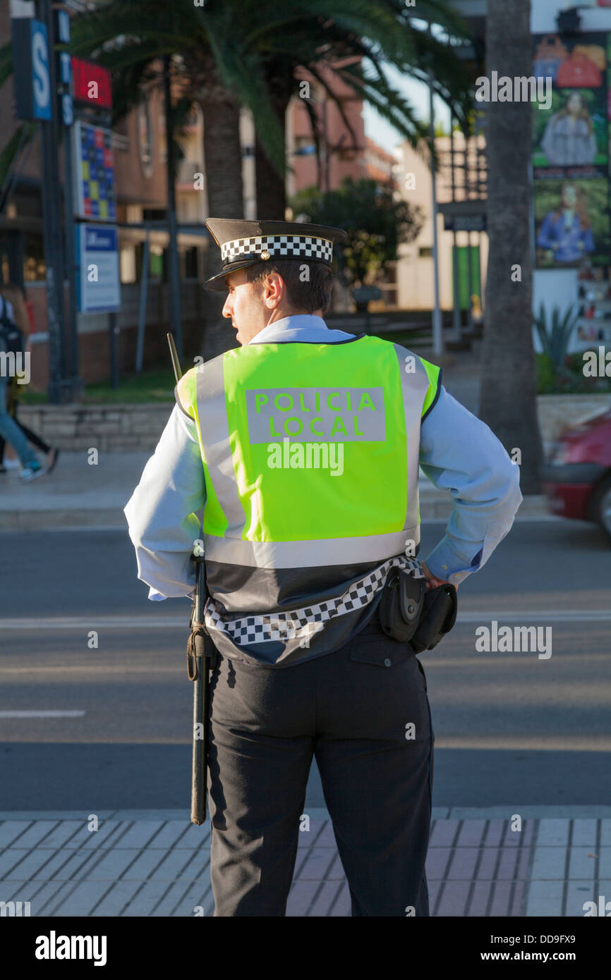 Back of policeman policia local looking to side. - Stock Image
