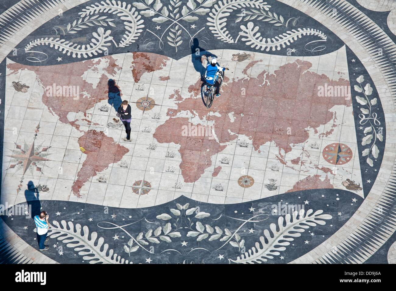 Tourists on a giant world map at the foot of the Monument to the Discoveries, Padrao dos Descobrimentos, Belem, - Stock Image