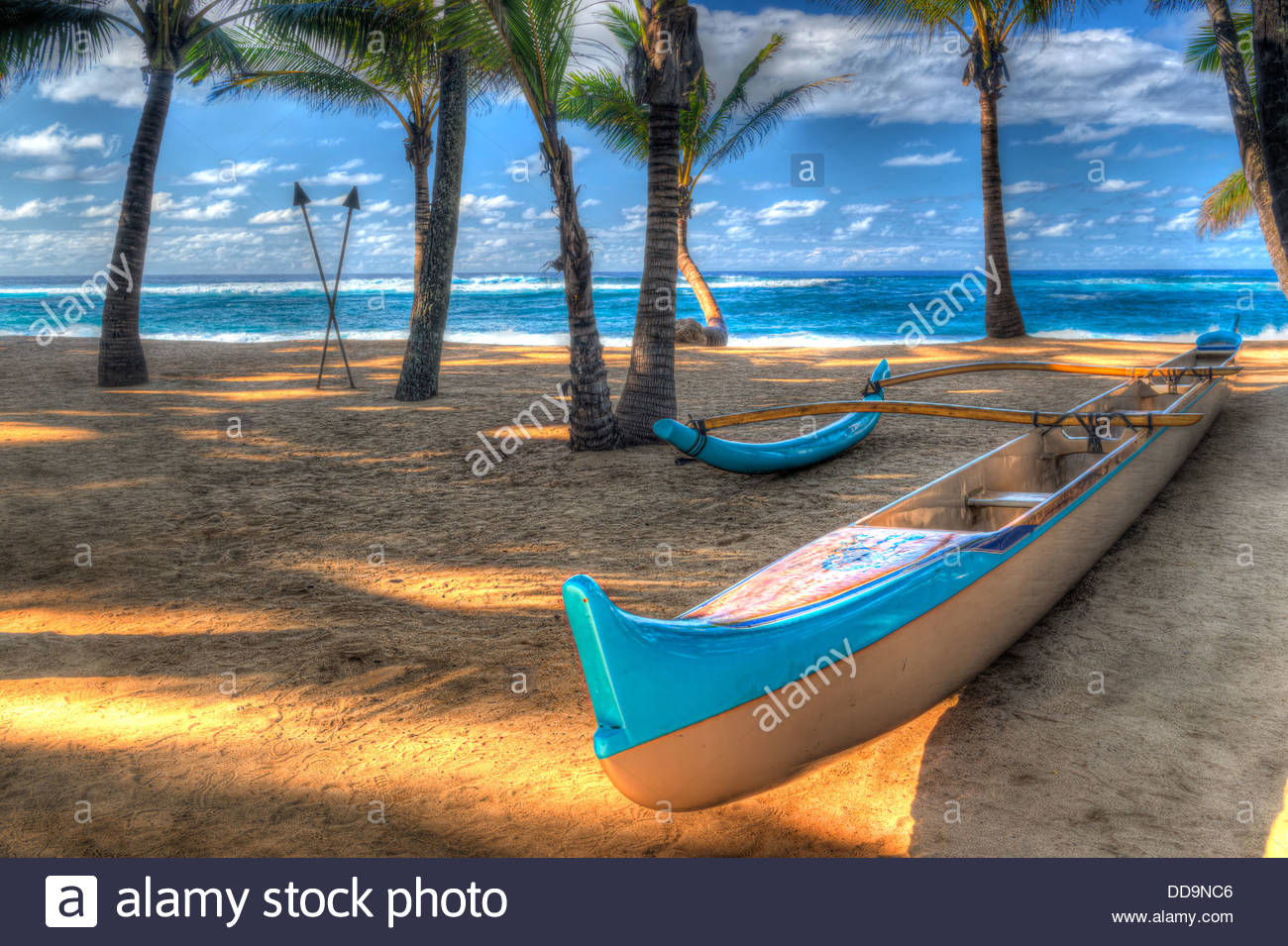 Outrigger canoe on a beach in Hawaii.  Photo has a surreal look.  It is shot using HDR technique. - Stock Image