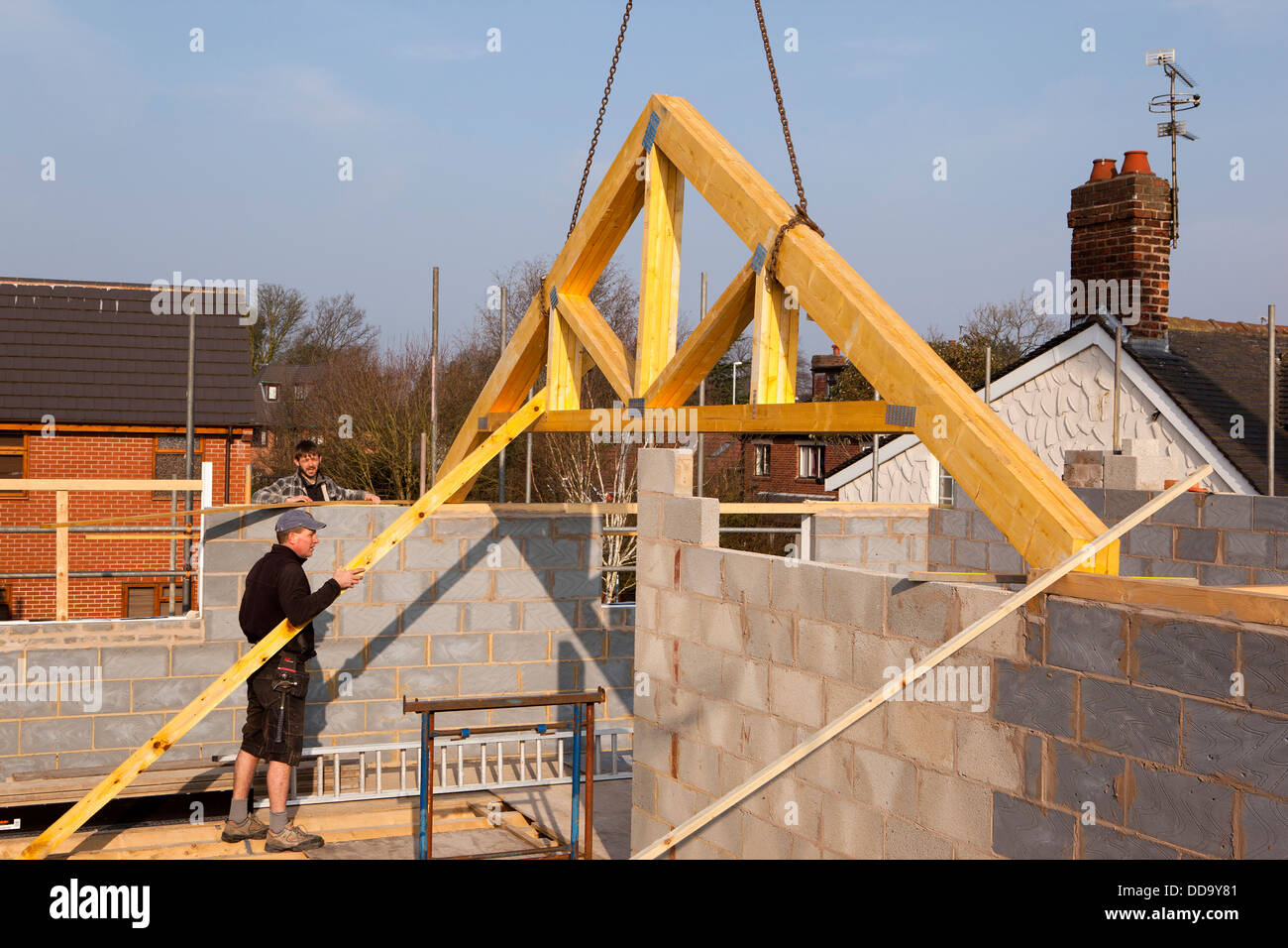 Self building house constructing roof lifting first for Where to buy trusses