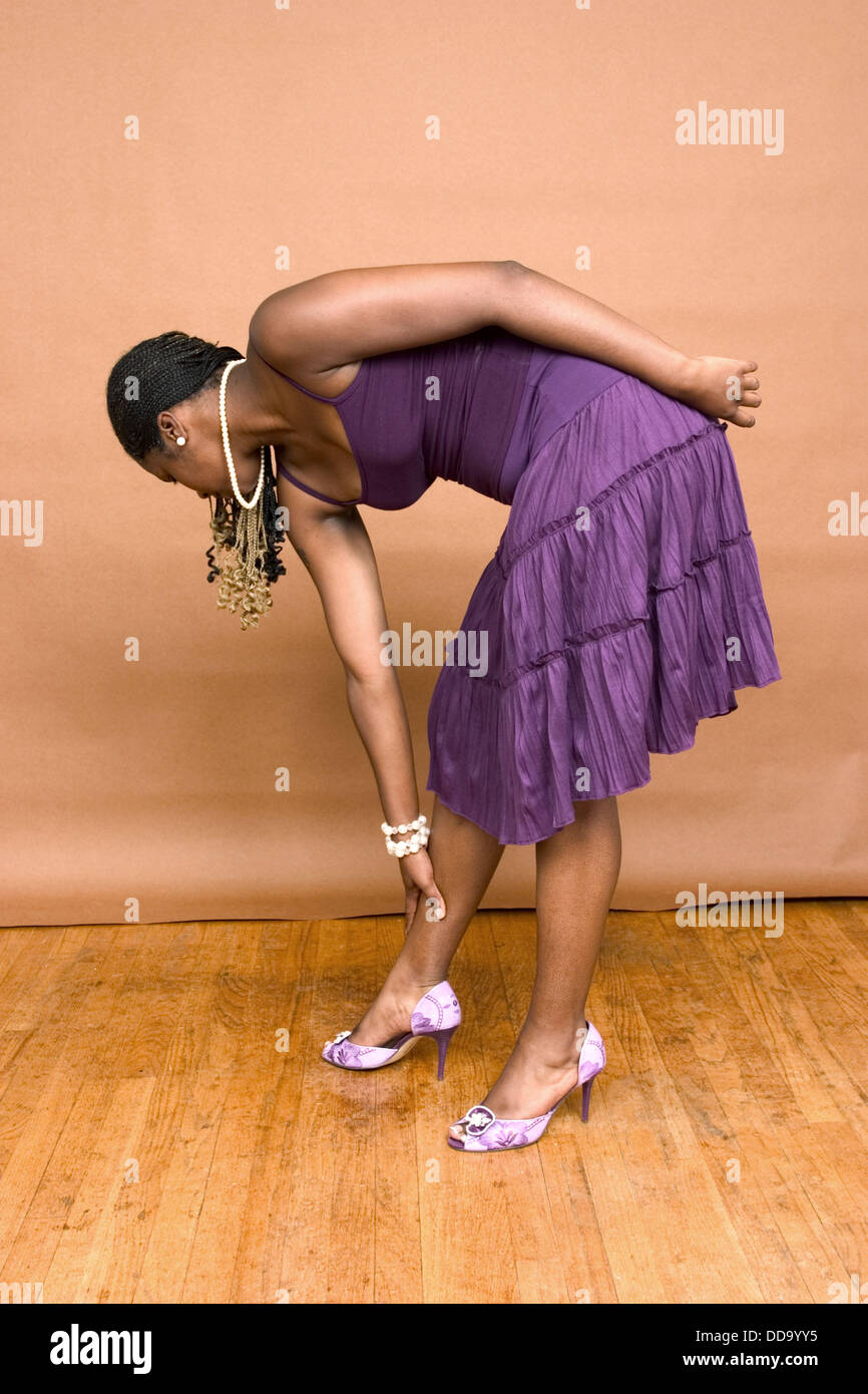 Women in dresses bending over