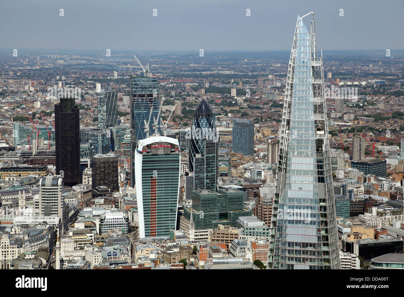 an aerial view of the City of London including The Shard and The Walkie-Talkie and Gherkin buildings - Stock Image