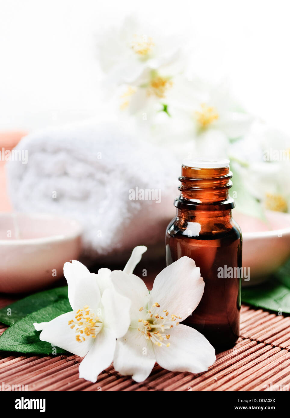 Essential Oil With Jasmine Flower On Wooden Background Stock Photo