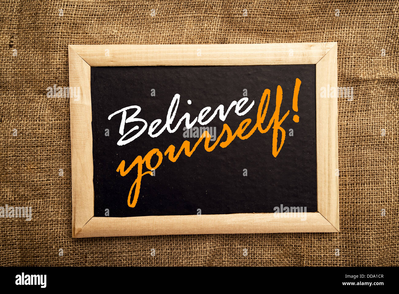 Believe yourself, motivational message on black board. - Stock Image