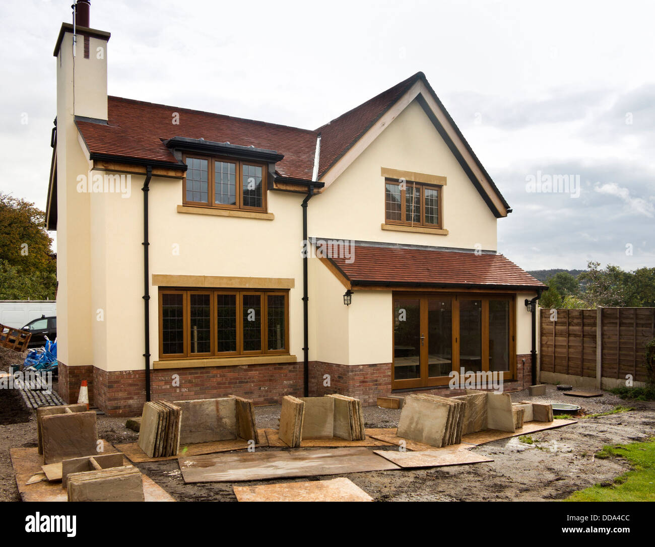 self building house, hard landscaping, sandstone paving slabs around edge of new-built property Stock Photo