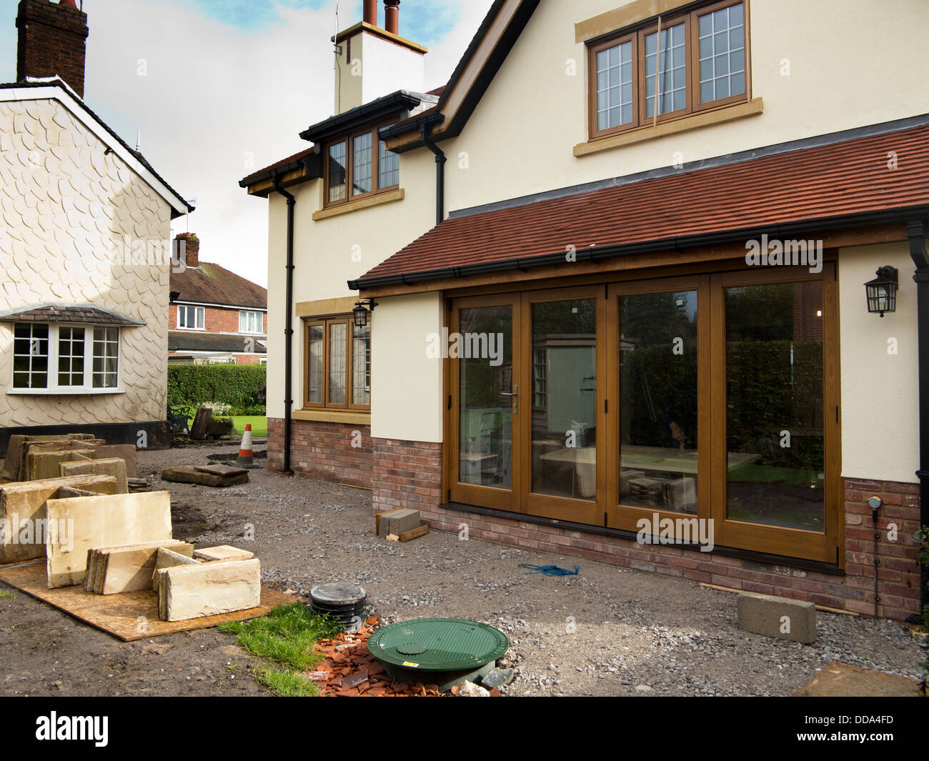 self building house, hard landscaping, sandstone patio paving slabs of new-built property - Stock Image