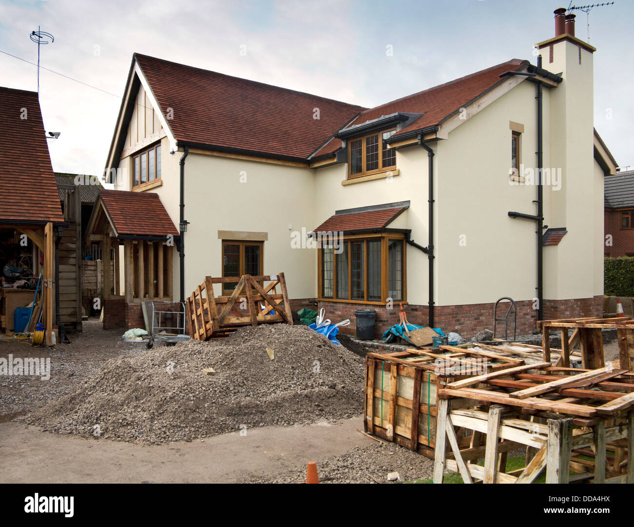 self building house, hard landscaping, pallets of sandstone paving slabs around edge of new-built property - Stock Image