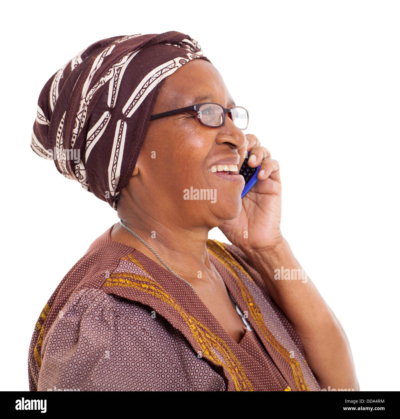 happy elderly African woman talking on smart phone on white background - Stock Image