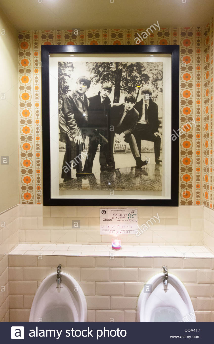 A very big framed photo of the Beatles in the men's toilets in The Snug Bar, Skerries, County Dublin, Ireland - Stock Image