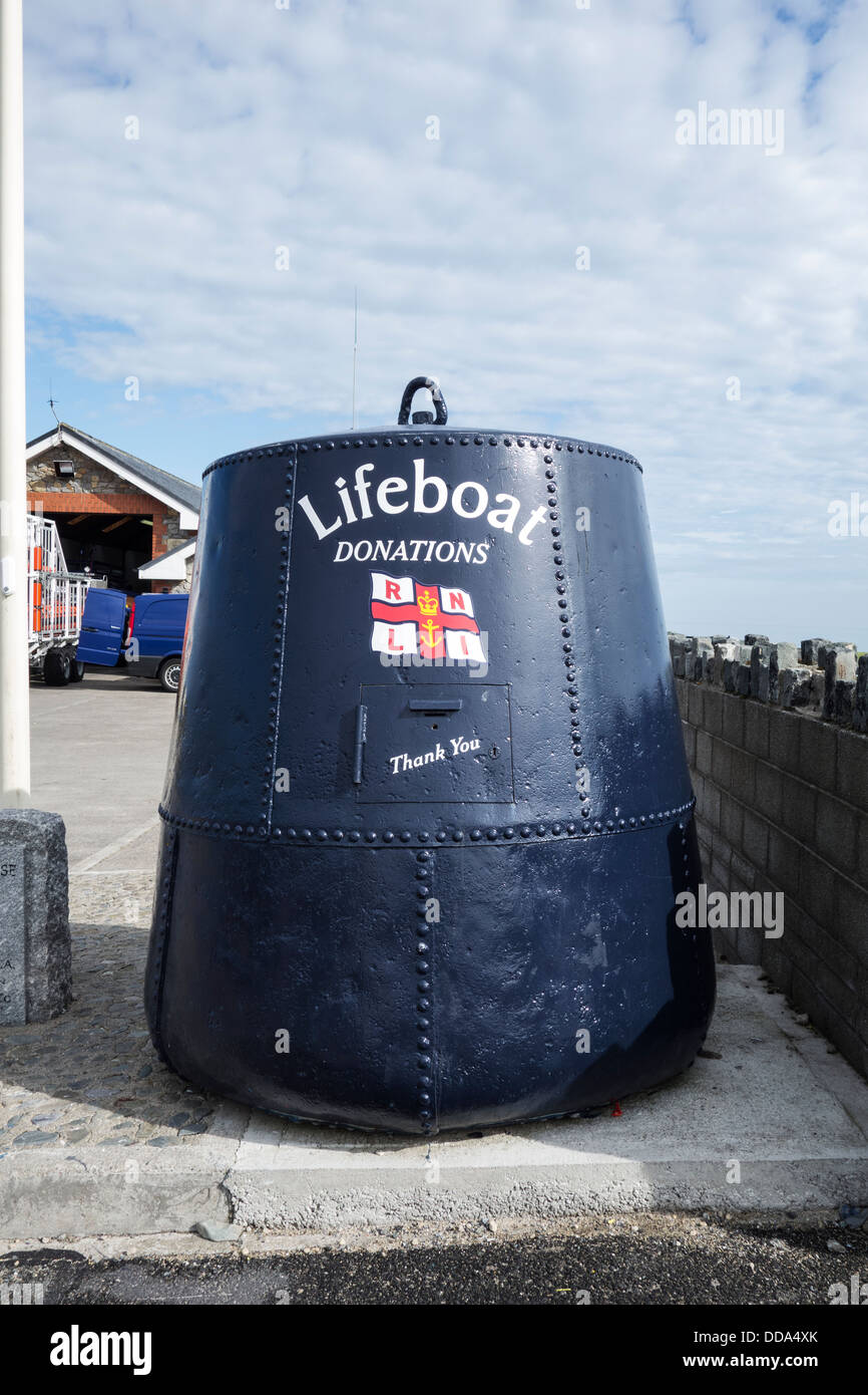 Old navigation buoy recycled to serve as a collecting box for the Royal National Lifeboat Institution, Skerries - Stock Image