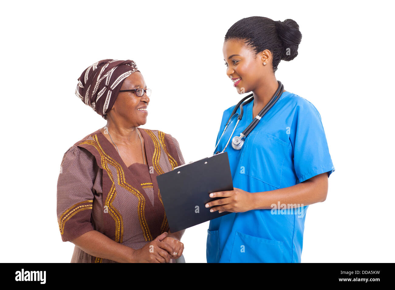 beautiful young African nurse helping senior woman with medical form - Stock Image