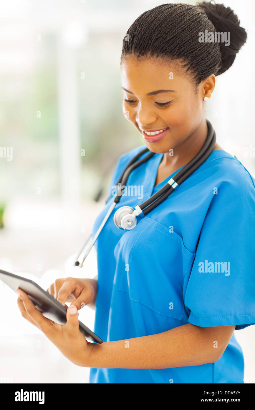 pretty afro American nurse using tablet pc - Stock Image