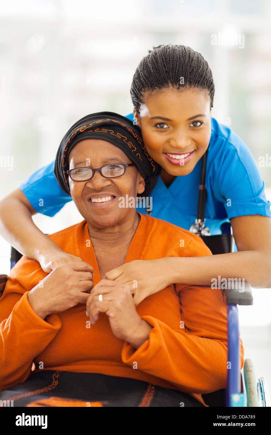 portrait of senior African disabled woman and her caregiver - Stock Image