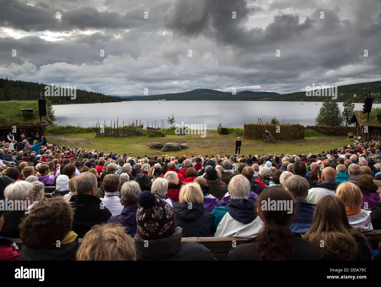 The 'chorus' gives his introduction by the shores of Lake Gala at dusk in the annual production of Ibsen's - Stock Image