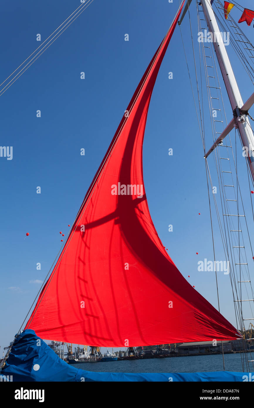 red sail closeup on clear sky - Stock Image
