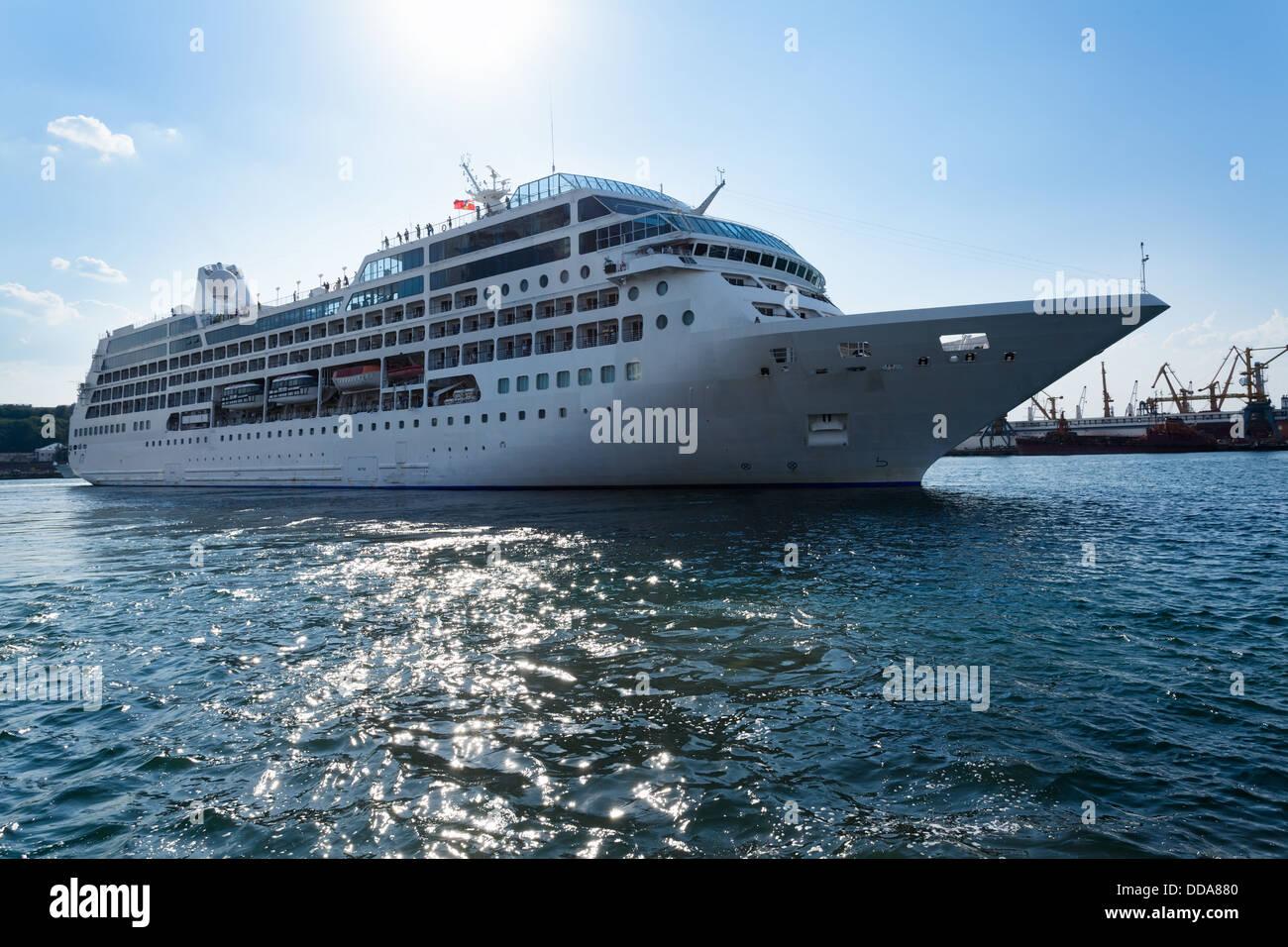 passenger ship afloat sparkling sea - Stock Image