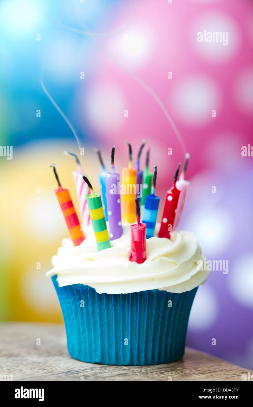 Cupcake With Extinguished Birthday Candles Stock Photo