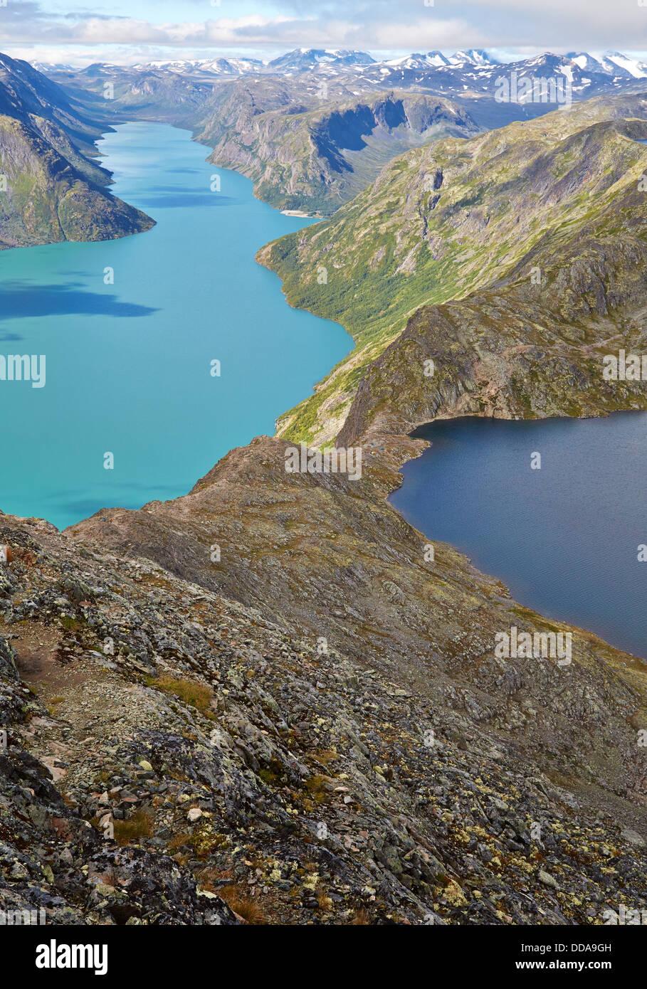 Besseggen Ridge walk in Jotunheimen National Park Norway navigates the narrow strip of rock between Lake Gjende - Stock Image