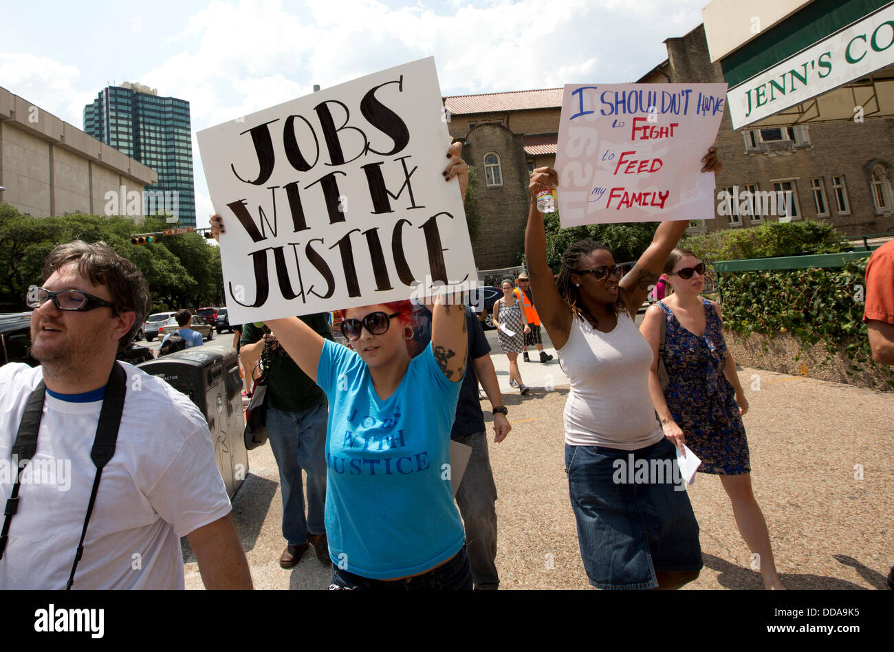 Austin, Texas USA: Fast-food workers and sympathizers march joining other U.S. cities protesting  low restaurant Stock Photo