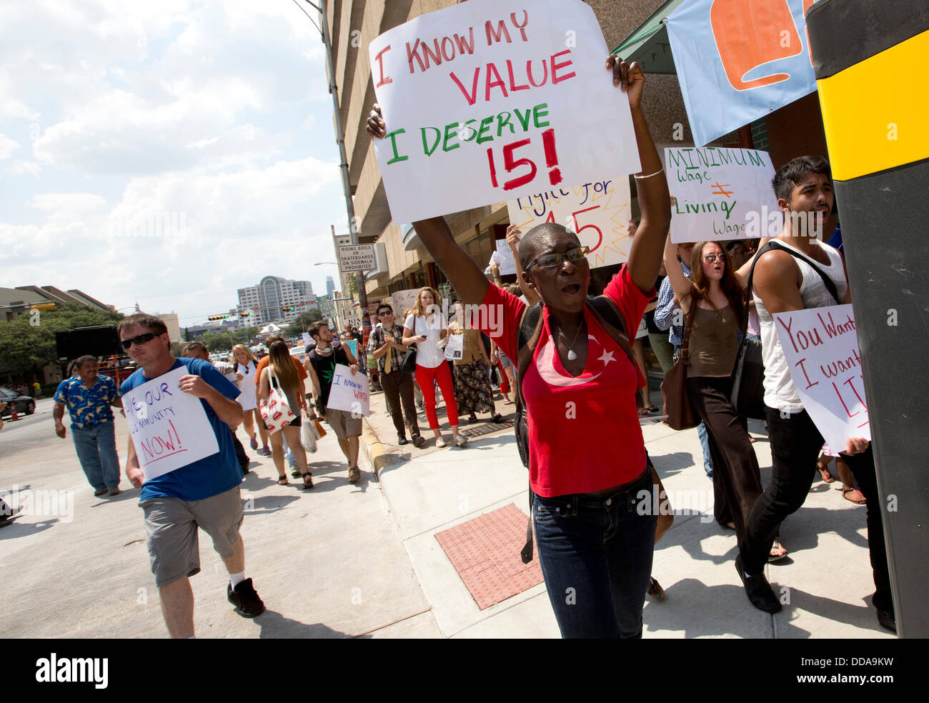 Austin, Texas USA: Fast-food workers and sympathizers march joining other U.S. cities protesting  low restaurant - Stock Image