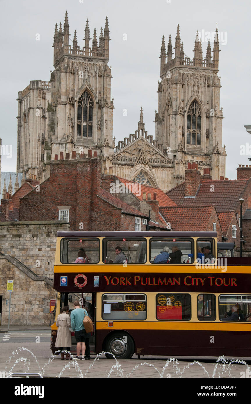 A view of York showing a York Pulman City Tour bus parked near Bootham Bar  with York Minster in the background. - Stock Image