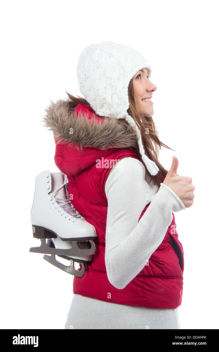 Pretty woman ice skating winter sport activity in white cap smiling facial and showing thumb up close-up isolated - Stock Image