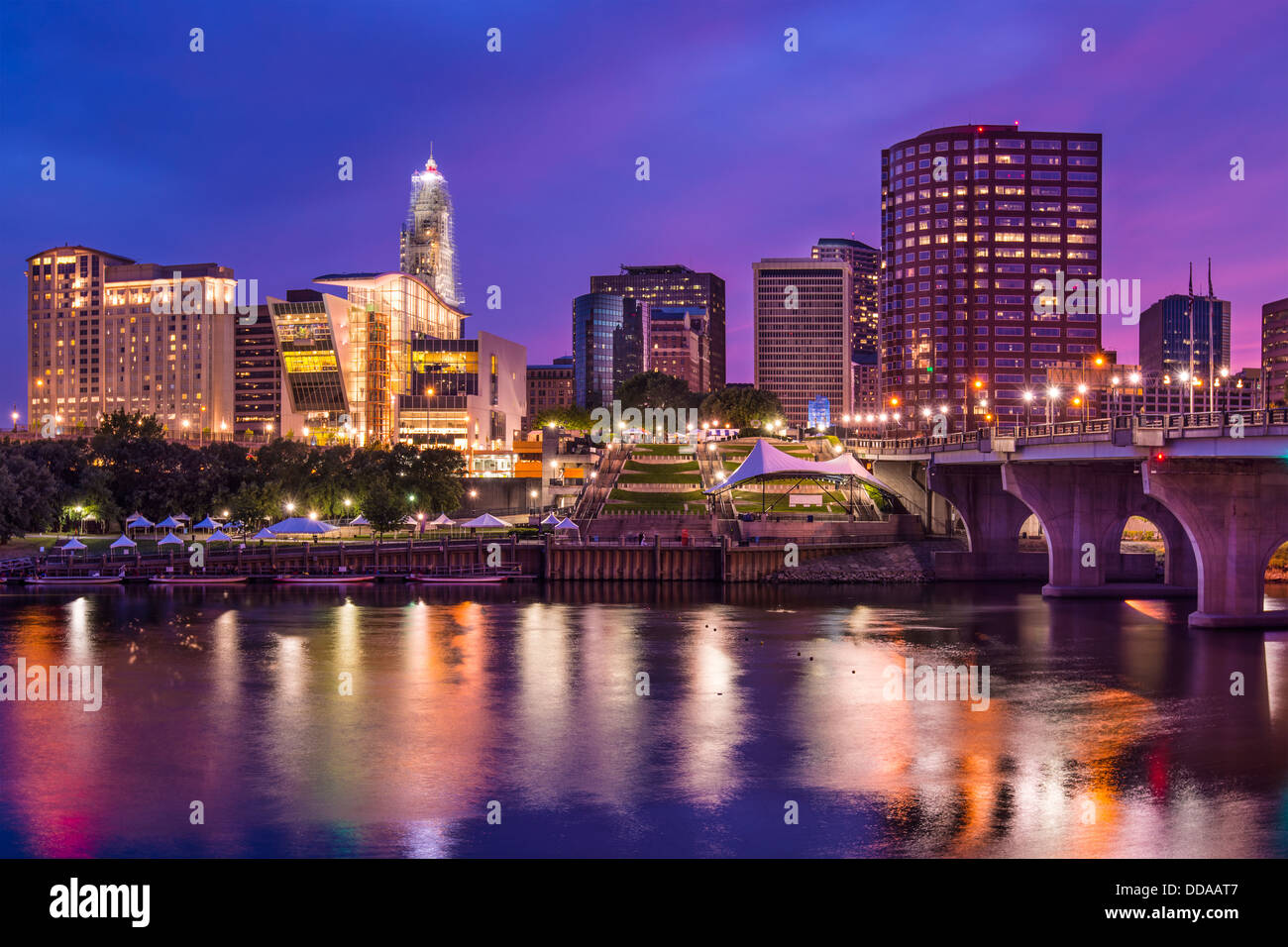 The skyline of downtown Hartford, Connecticut at dusk from across the Connecticut River. - Stock Image