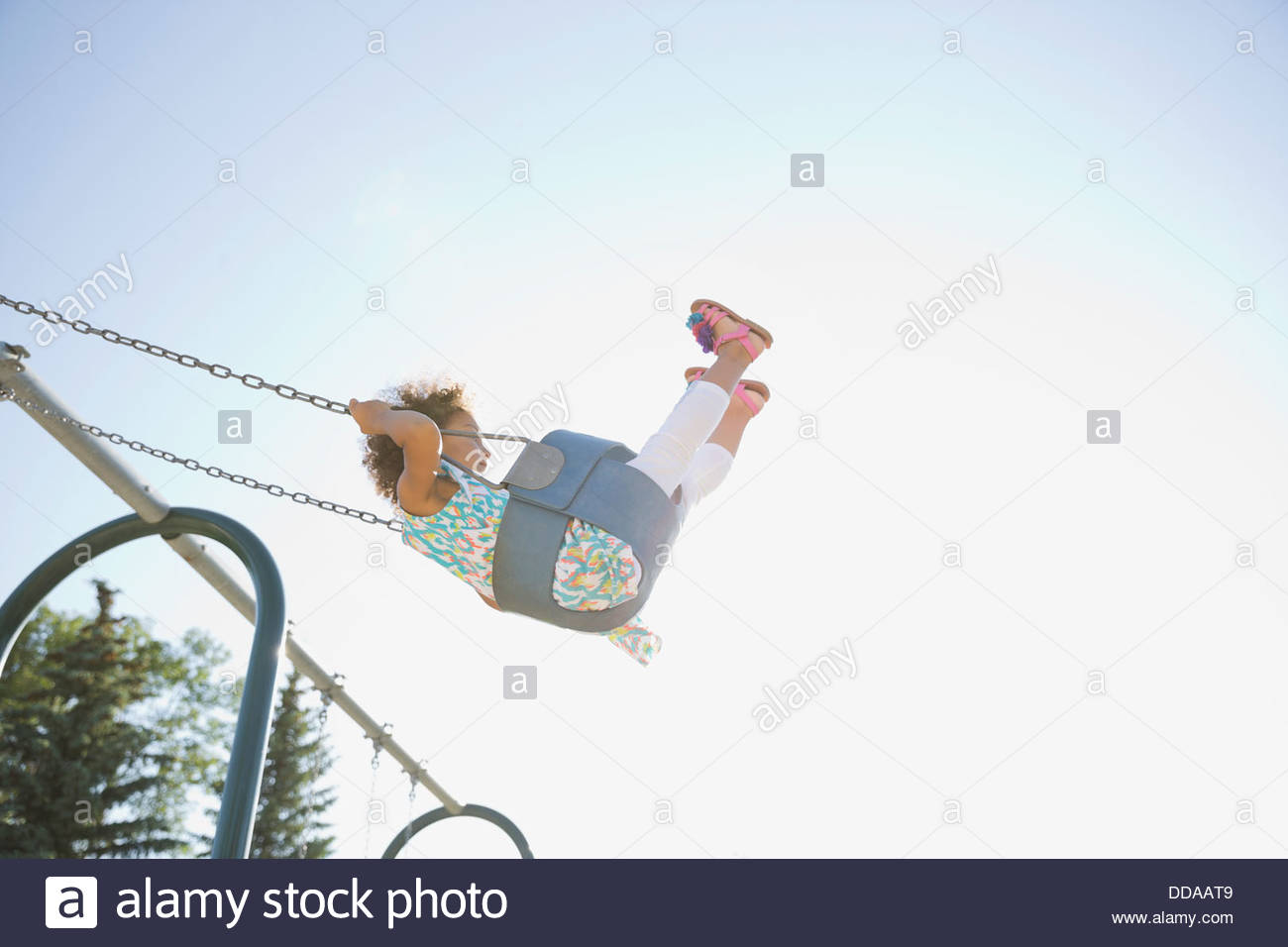Little girl on swings - Stock Image