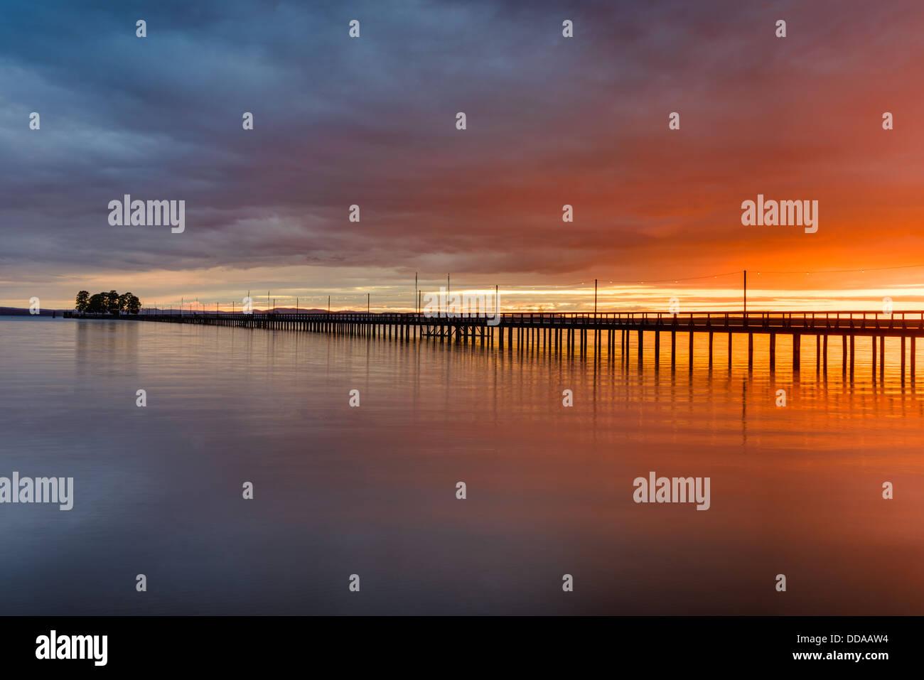 Pier on lake at sunset, Rättvik, Dalarna, Sweden - Stock Image
