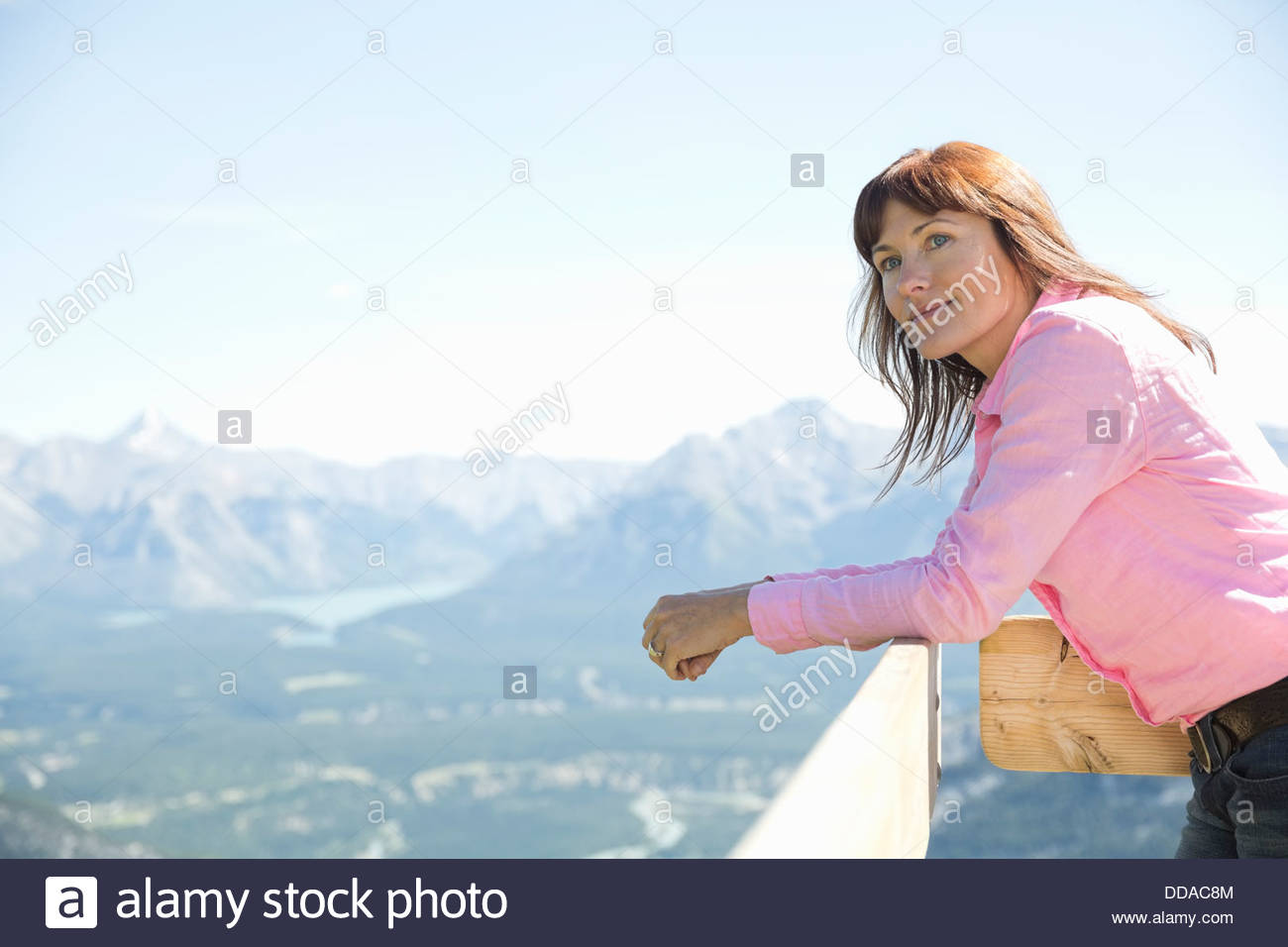 Woman looking out on mountain view - Stock Image