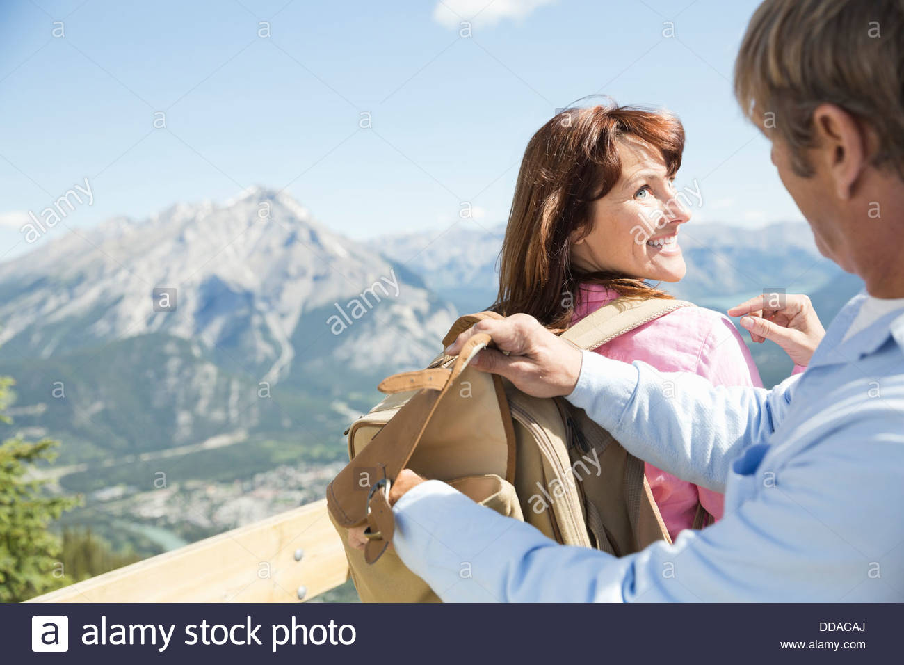 Man searching through backpack - Stock Image