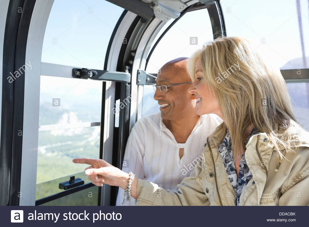 Couple looking out on gondola - Stock Image