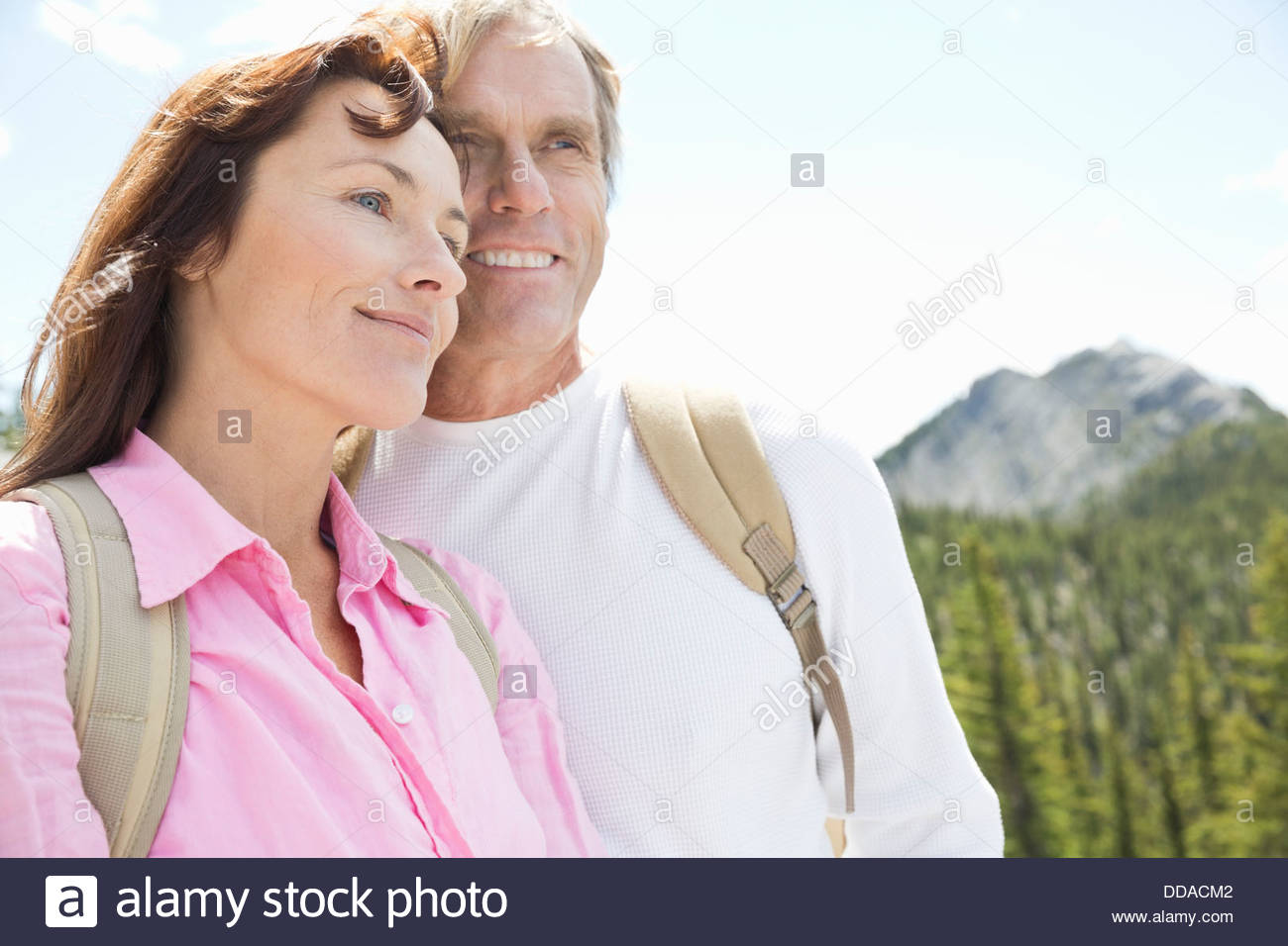 Active couple smiling outdoors - Stock Image