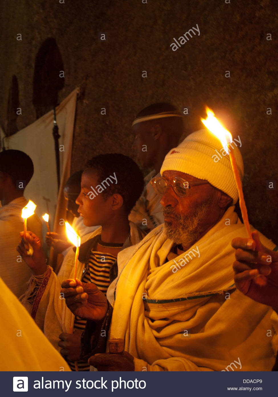 Pilgrims in Easter night procession in Lalibela - Stock Image