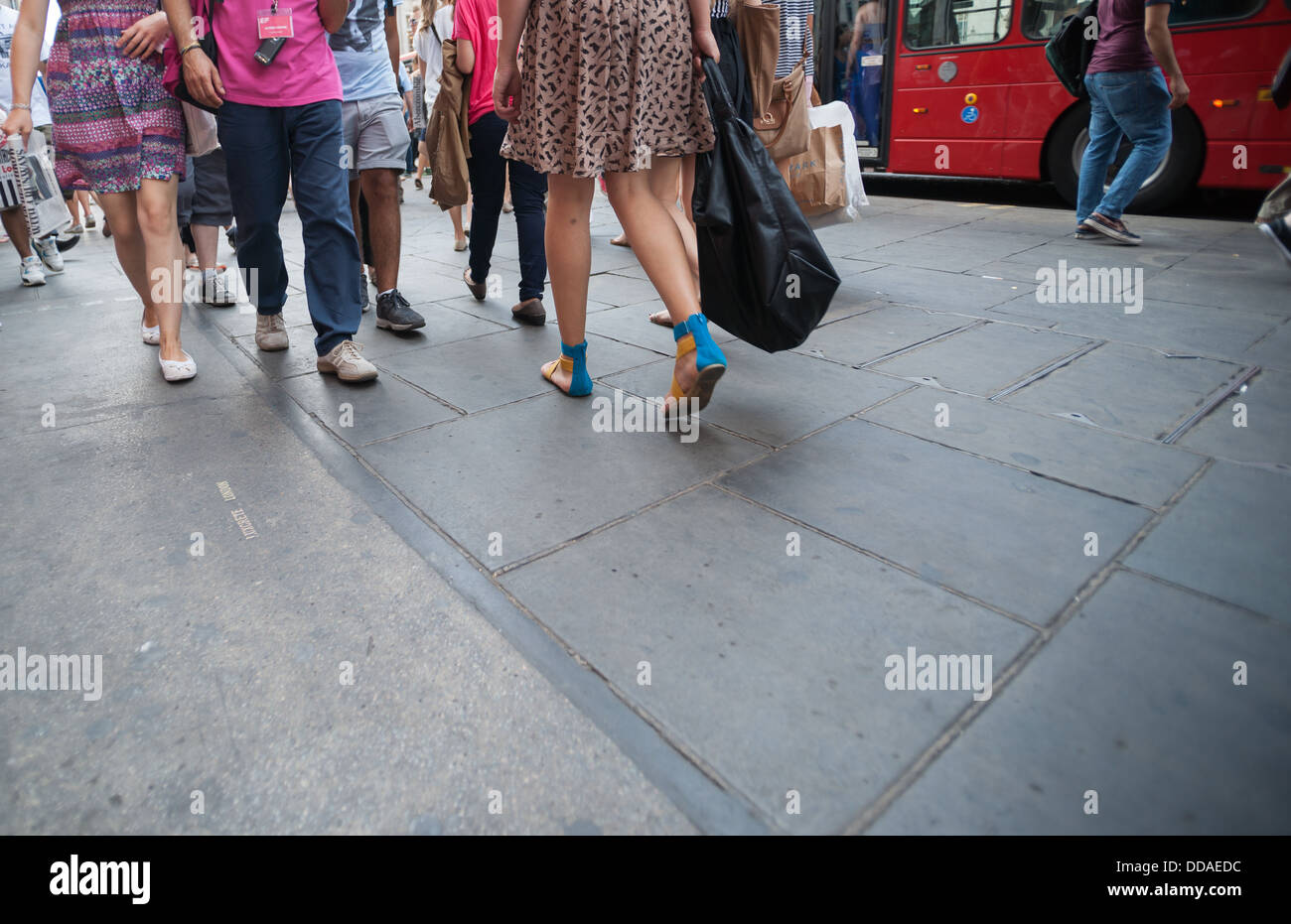 Busy London street as people walk by. No recognisable people or property. - Stock Image