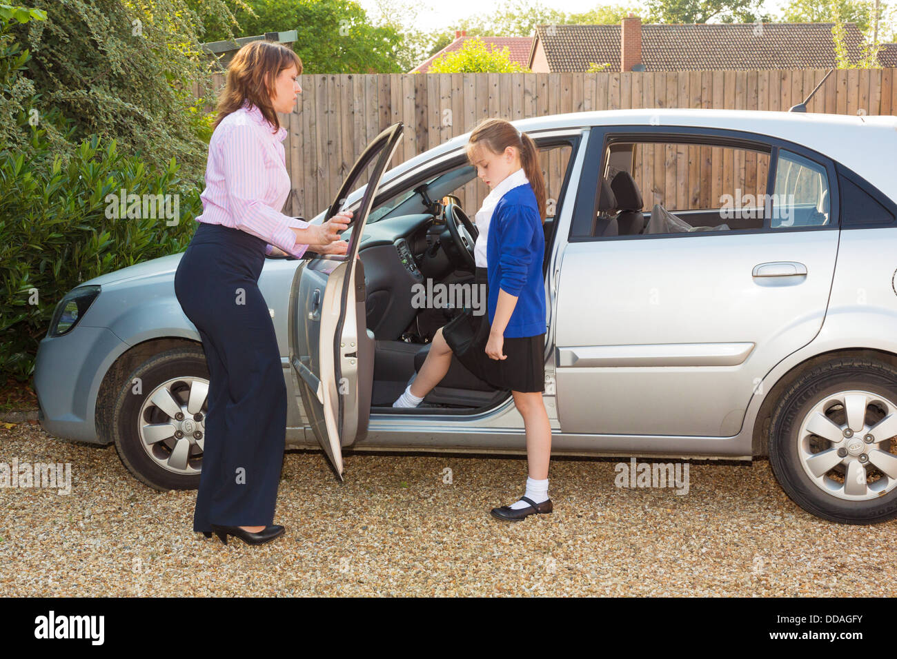 mother taking daughter to school in morning - Stock Image