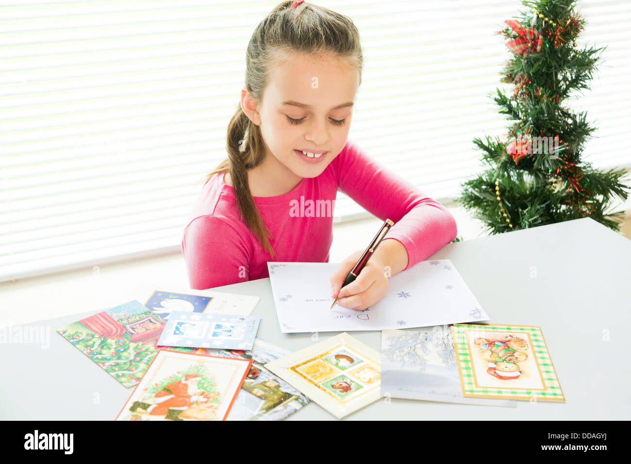 young girl filling in christmas cards stock photo 59854470 alamy