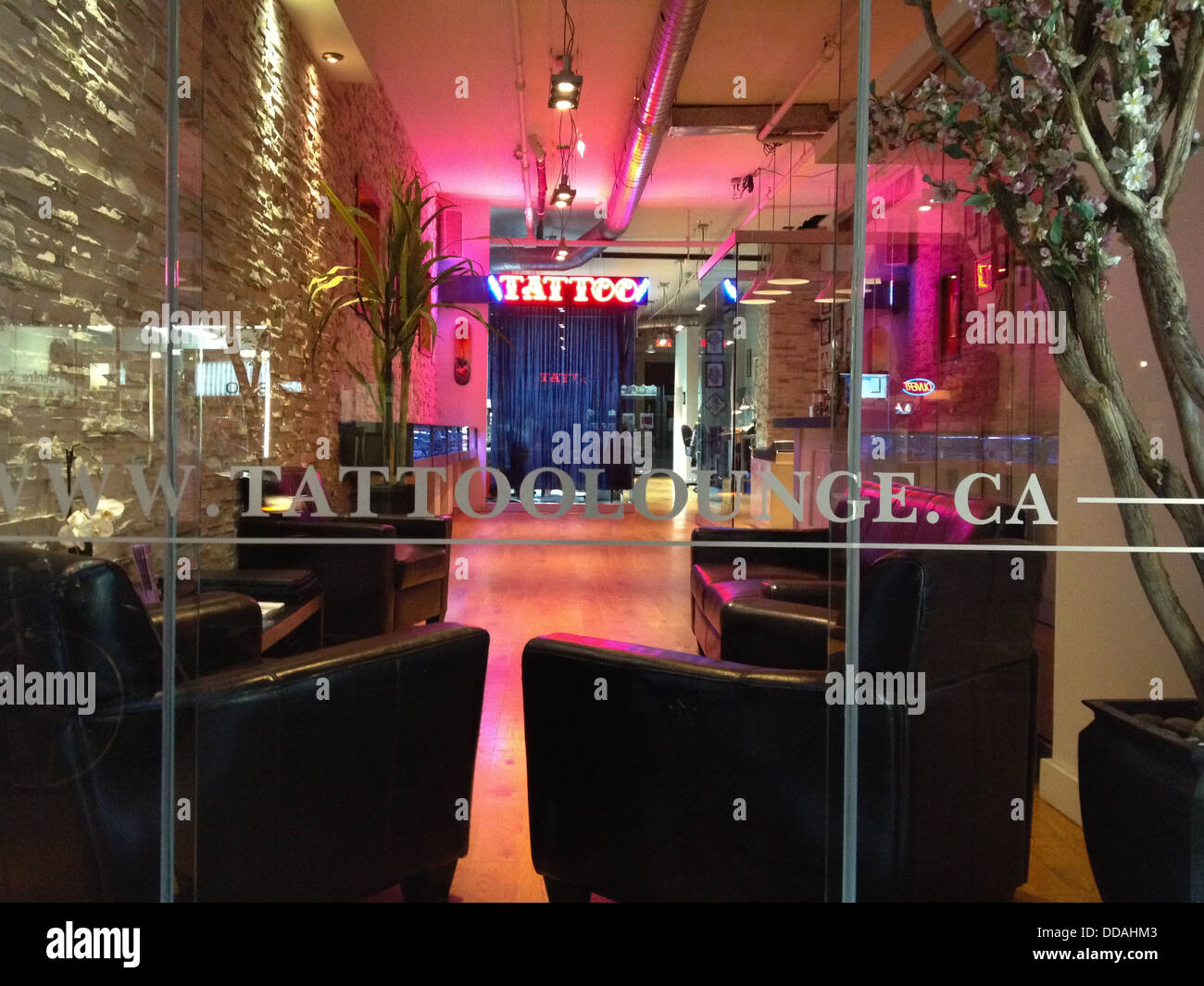 Boulevard St-Laurent in Montreal is the hip place to be. Here the famous tattoo lounge - Stock Image