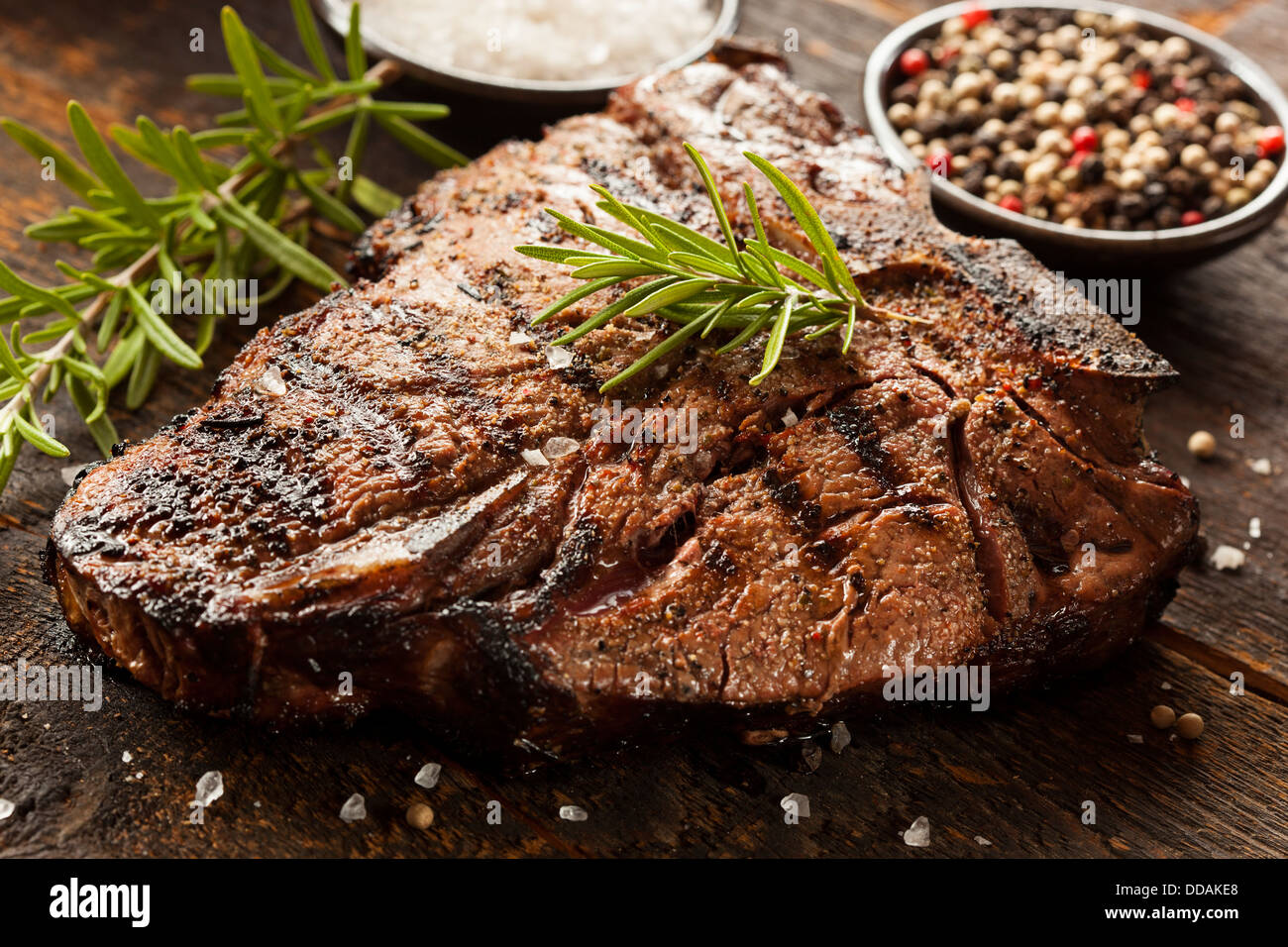Grilled BBQ T-Bone Steak with Fresh Rosemary - Stock Image