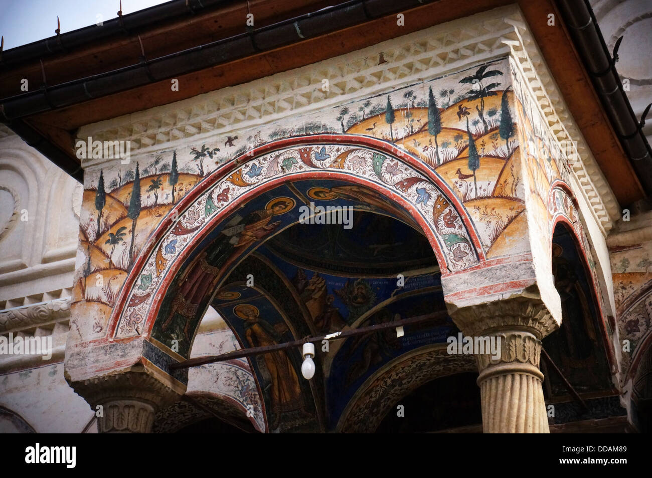 Painted decorations on the church of the Polivragi Museum in Romania - Stock Image