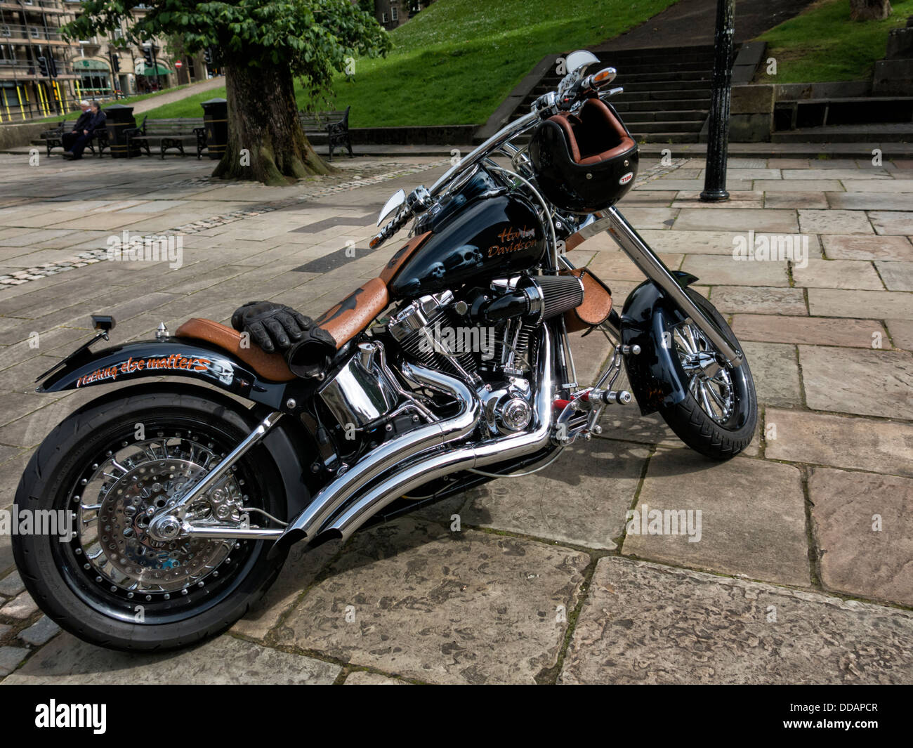 Custom motorbike parked on street in Buxton Derbyshire England - Stock Image