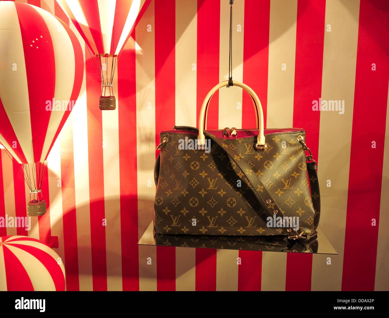 39ecedc7d7 Louis Vuitton womens luxury designer handbag in shop window Stock ...