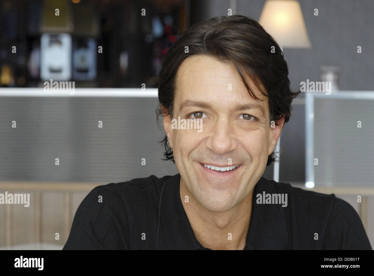 40-45 year old white male, seated in a bar/café - Stock Image