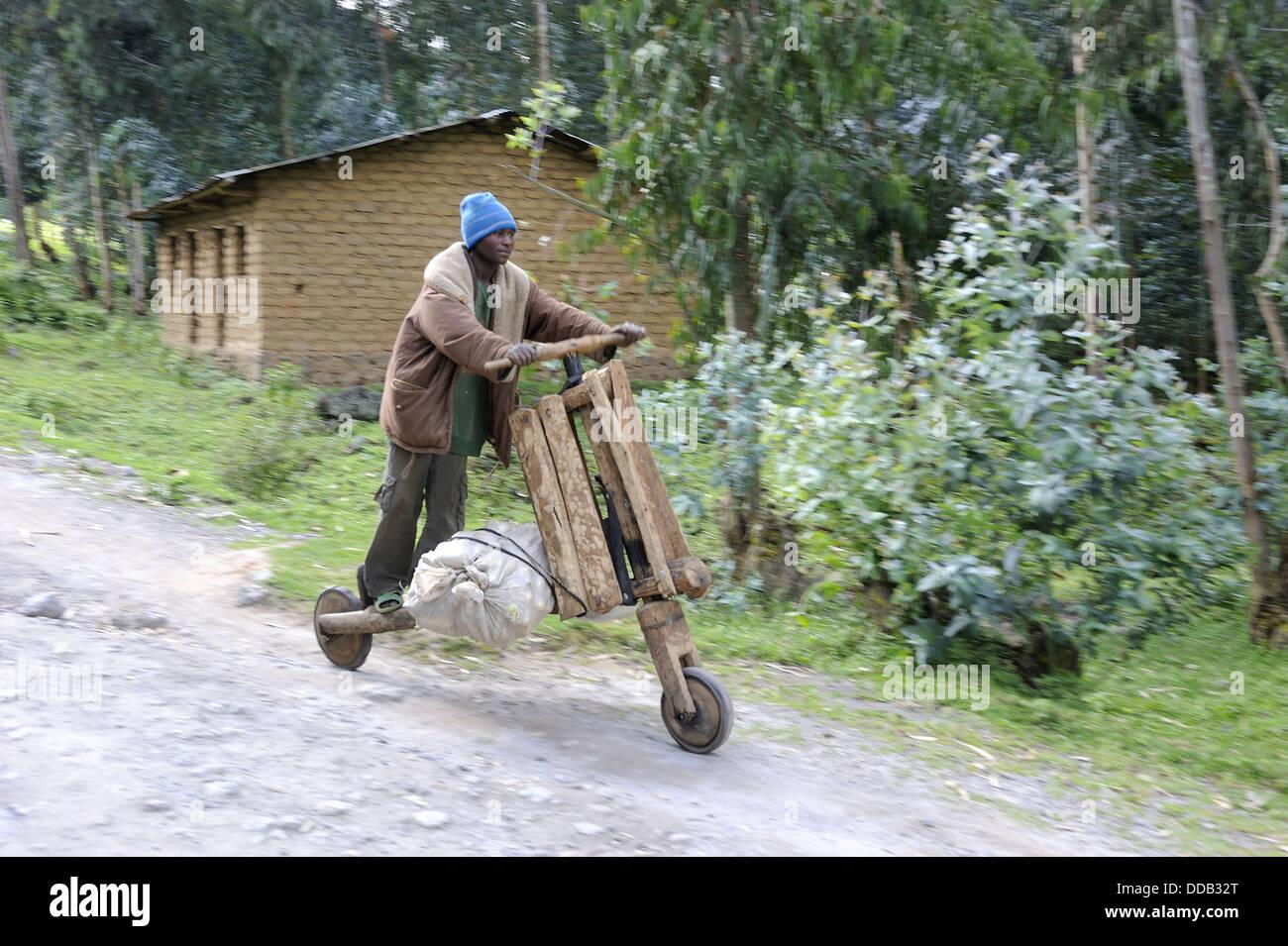 Man on hand made wooden bicycle, Rwanda, Africa - Stock Image