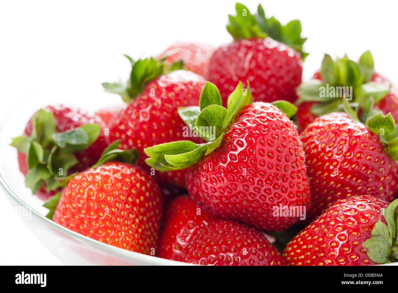 Rip strawberry on white background - Stock Image