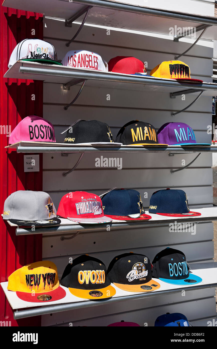 Baseball caps for sale outside a shop England UK United Kingdom GB Great Britain - Stock Image