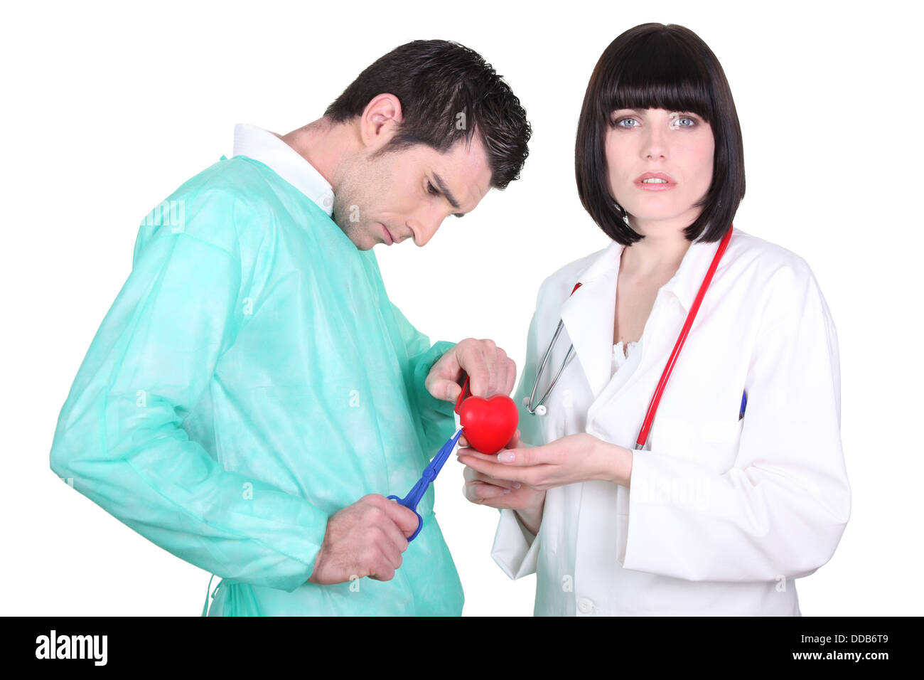 Doctors performing open heart surgery - Stock Image