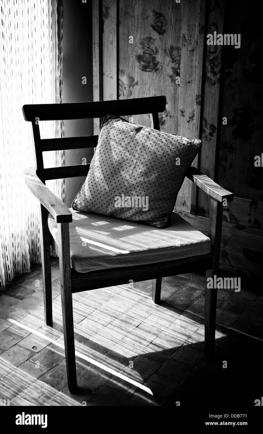 A chair in a cozy corner room  Light and shadow - Stock Image