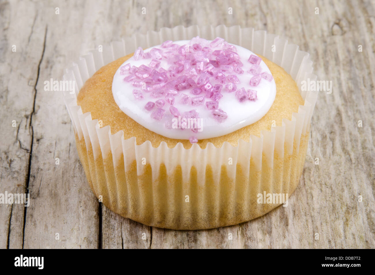 home made cup cake with pink shimmer sugar - Stock Image